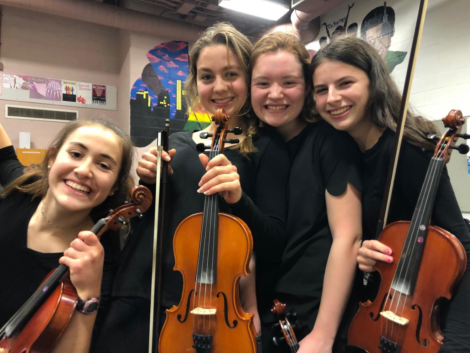 Taken by Delaney Coppola From left: sophomores Elle Cavanaugh, Katy Mulflur, Maddie Aylward, and Caroline Bastardi smile for a photo before performing onstage.