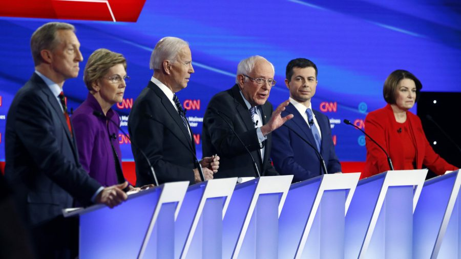 The+democratic+candidates+stand+on+the+debate+stage.+