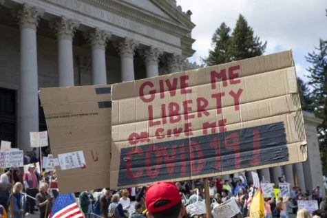 In Olympia, Washington, hundreds of protesters crowded the Capitol building on April 19th, carrying signs with aggressive messages and violating social distancing guidelines.