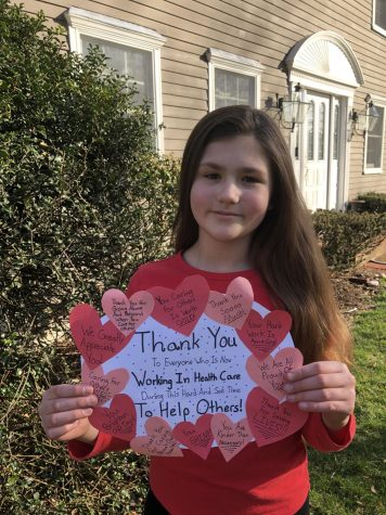 Fifth grader and Harborlight contributor Vivianne Kust holds up th sign of gratitude she made during this quarantine.