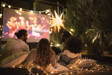 Instead of going to the movie theaters this summer, try bringing the theater right into your backyard!
