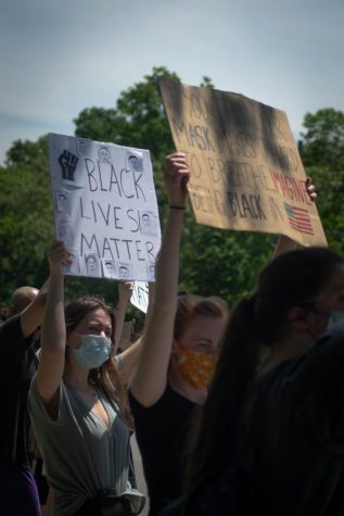 The pictures of victims were displayed on poster board and held up by various protesters.