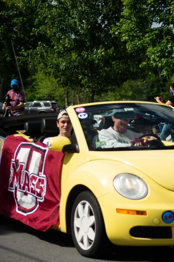 Seniors Liam Keliher and Briggs Rowley parade through the crowd. Keliher will be attending University of Massachusetts Amherst while Rowley will be attending University Of Vermont.