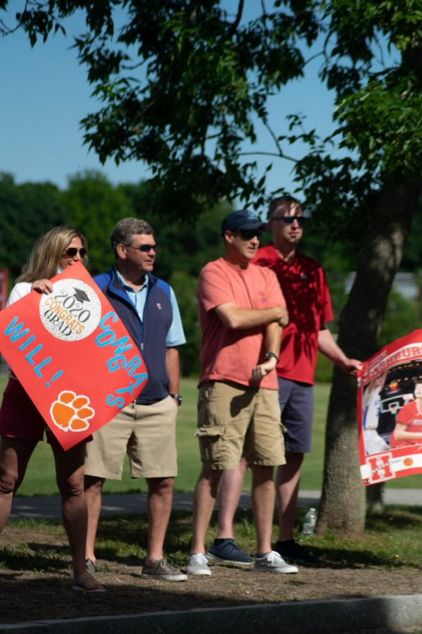 Senior Will OConnell was welcomed by family members on the Hingham Highschool field.