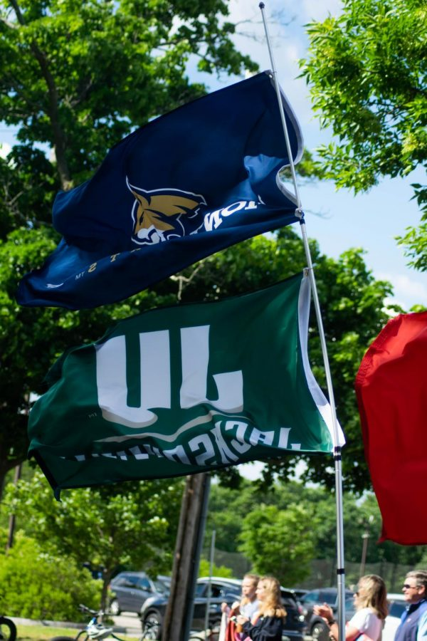 Montana State and Jacksonville flags were hung on a passing car.