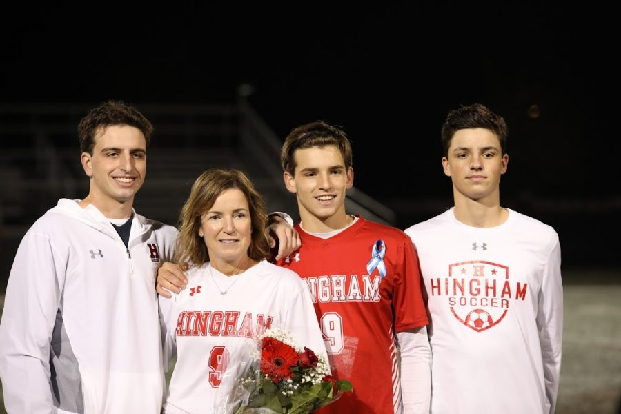 Finally%2C+Senior+Andrew+Teague+is+pictured+at+center+field+with+his+Brothers+and+Mother%2C+standing+proudly+in+the+memory+of+their+father.