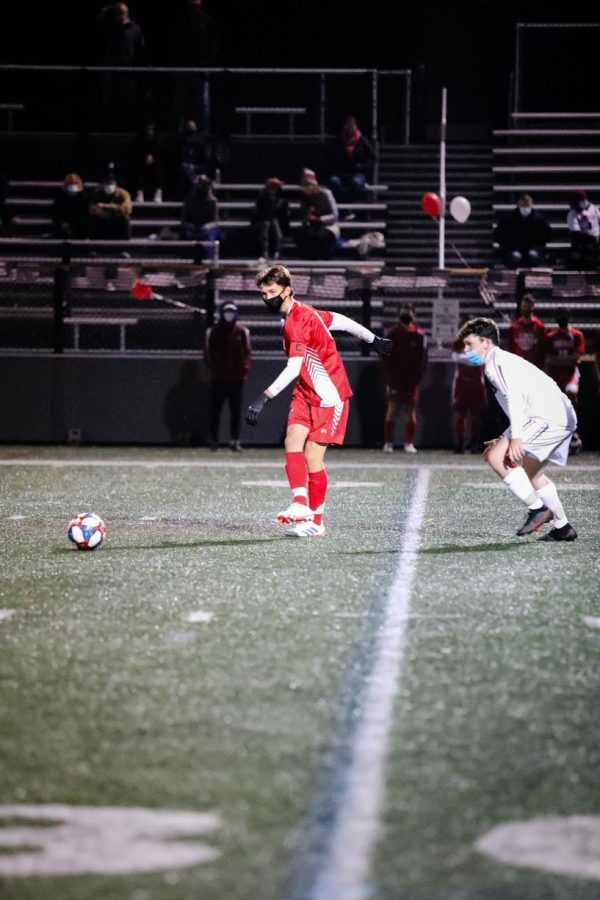 Senior Will Fetsko gets ready to kick the ball in the first quarter.