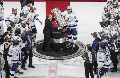 After being injured for most of the series, Lightning Captain Steven Stamkos joins his team's celebration, hoisting the Stanley Cup.