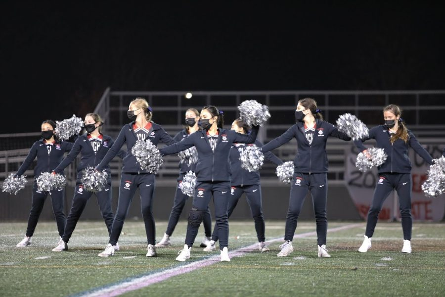 Hingham High school talented dance team takes the center field to perform during halftime, sporting Blue Blows in memory of Mr. Teague.