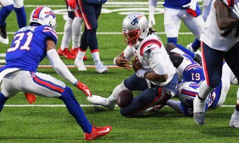 Patriots quarterback Cam Newton fumbles the ball in a crucial fourth quarter effort.