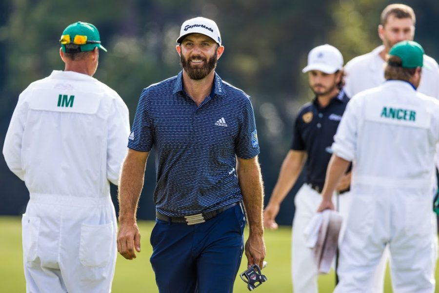 Dustin Johnson walks off of the 14th green after making a birdie putt.