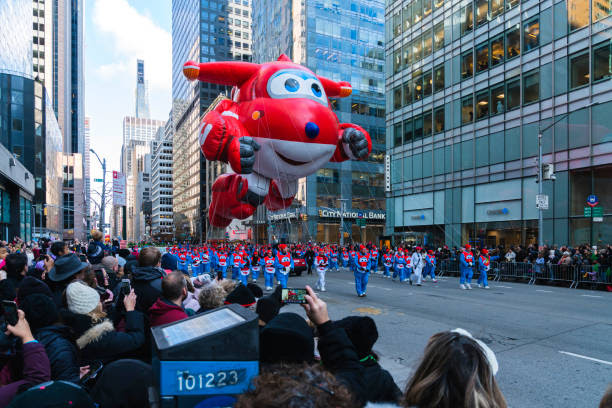 Last year's parade with full crowds, a sharp contrast from this years empty crowds.