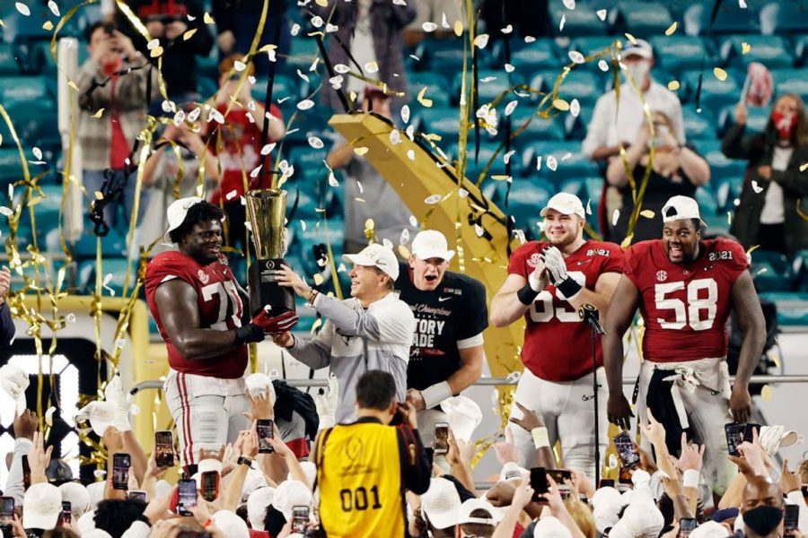 Alabama coach Nick Saban celebrating his 7th National Championship victory with his players following their 52-24 win versus Ohio State.