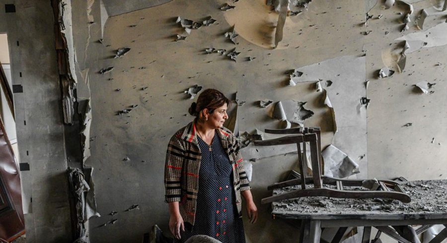 A woman stands amid the destruction caused by the most recent flare-up in Nagorno-Karabakh.