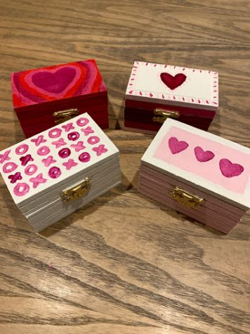 One of the many creative valentine alternatives to a typical get-together includes painting jewelry or gift boxes.
