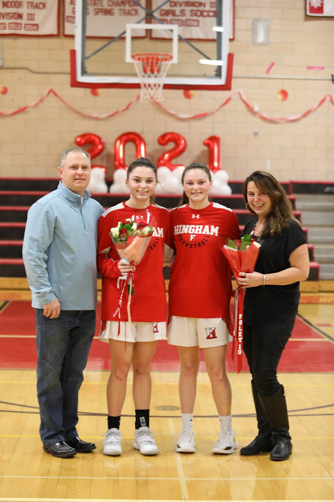 Senior Abbey Foley poses with her parents, Sue and Mike, and younger sister.