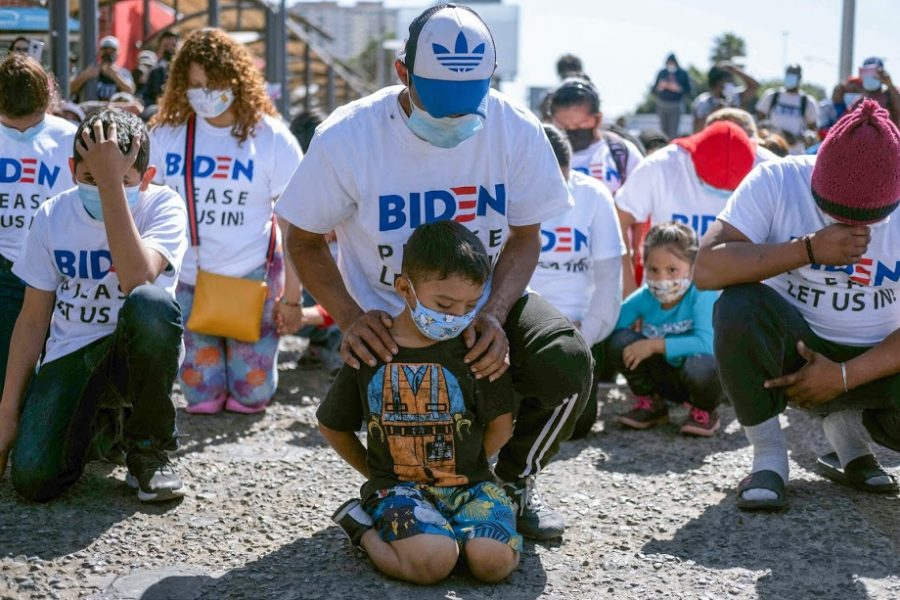 Migrants protesting for comprehensive immigration policies from president Biden on the Mexican border.