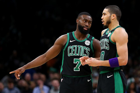 Jaylen Brown and Jayson Tatum of the Celtics talk during a game against the Houston Rockets.