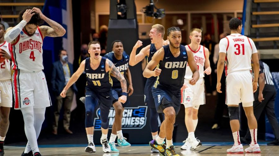 Flying+high%2C+the+15-seeded+Oral+Roberts+Golden+Eagles+celebrate+an+upset+victory+over+the+2-seeded+Ohio+State+Buckeyes.