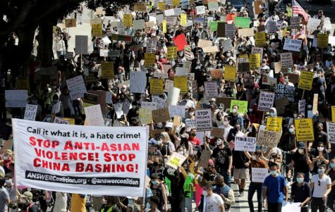 A large crowd gathers to protest anti-Asian violence and racism on March 27, 2021, in Los Angeles.