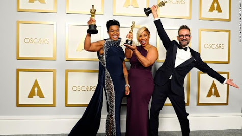 Mia Neal, Jamika Wilson, and Sergio Lopez-Rivera celebrate for a photo, holding their Oscars they won for best makeup and hairstyling.