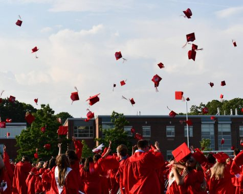 The Class of 2021 throws their caps in the air in celebration at the end of the ceremony.