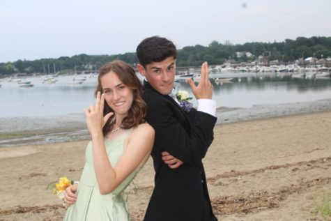 Voted best couple at HHS, Olivia Spielberger and Brian Fennelly strike a pose at the Harbor before leaving for prom.