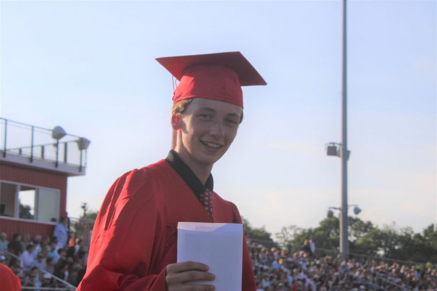 Kevin Ierardi shows off his diploma.